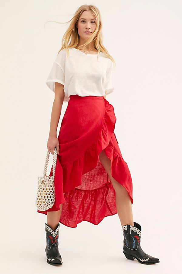 ba07c0c556b American made wrap skirt featured in a lightweight luxe linen fabric.  Ruffle trim