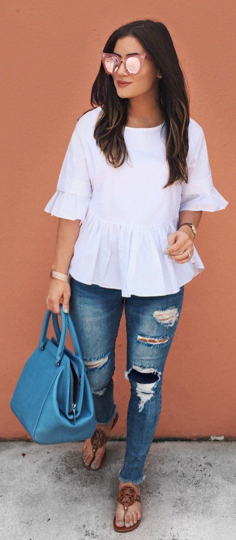 #spring #outfits White Flare Top + Ripped Skinny Jeans + Blue Leather Tote Bag