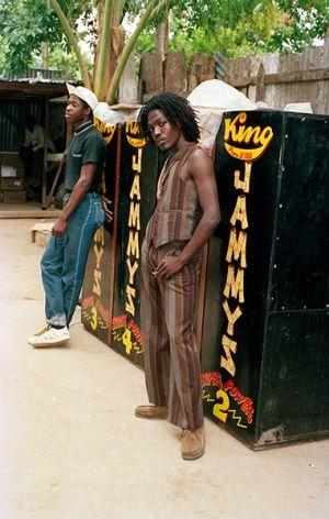Jamaican Musicians: Junior Reid wearing Wallabees in King Jammy's yard , Kingston, Jamaica 1986