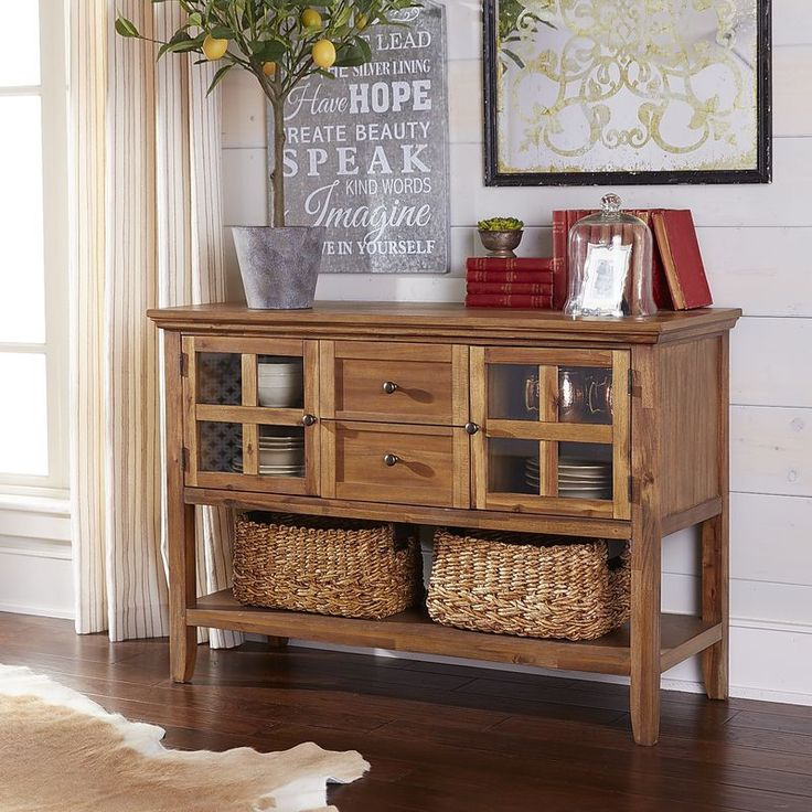 Ronan has traditional good looks, especially if you have a tradition of needing more storage. Our timeless buffet features solid wood construction with a rich, lacquered finish. Two glass-paned side cabinets have interior shelves, two recessed panel drawers provide room for flatware, and a full-length lower shelf gives you display space for baskets or large serving pieces.