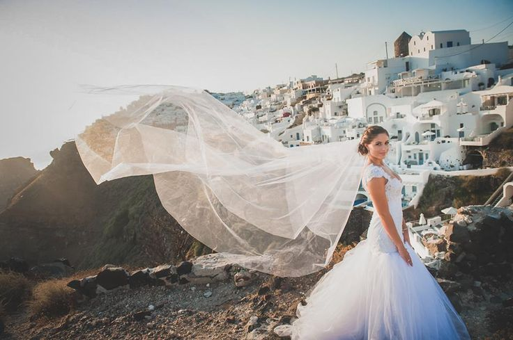 Beautiful Kathia Dobo mermaid wedding dress made of tulle and lace sewed with pearls
