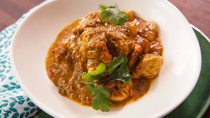 5 minute chicken curry. All it takes is a jar of garlic, red chilli and tomato chutney. Recipe by Anjum Anand.