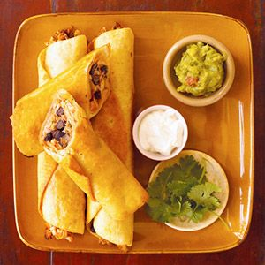 "Chicken Flautas with Black Beans Flauta is the Spanish word for ""flute"" -- exactly what one of these crispy, stuffed, and fried tortillas resembles. Use them to scoop up gobs of guacamole and sour cream. Try the make-ahead directions for dinner in a flash."