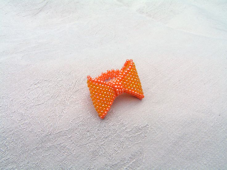 Bead bow ring  --    I made a tiny bright orange bead bow,  which can be showy, but not ostentatious accessory for the festive wear.   The basis of the ring I beaded to elastic tape.  The bow size is 3.8 cm * 2.6 cm.