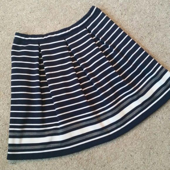 """Max Studio Dark Navy Striped A-Line Skirt Soft & flirty, this puckered polyester blend skirt has an ability to make your legs look miles long. Stripes abound adding interest & a touch of warm weather romance. With the breathable polyester blend you'll wear it everywhere from the office to the beach. Dressed up or down, you'll wear it all season long. Retails for $68.  Details: *Size Medium *Dark Navy, Ivory, Grey *Elasticized waist *Length 19.5"""" *On-seam side pockets *74% Polyester, 24%…"""