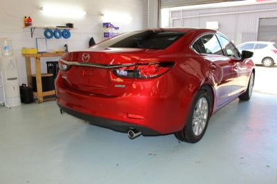 Red Mazda with Cool Car Window Tint installed. Looks and feels cooler, does not stretch your budget. Contact We Tint Windows for car tinting Brisbane.