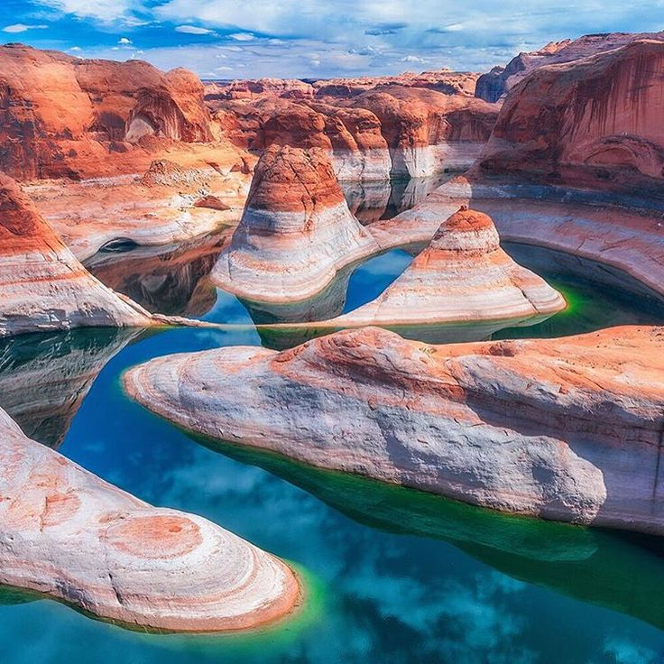 Reflections Canyon - Located in a remote section of Glen Canyon National Recreation Area in Utah, Reflection Canyon offers unparalleled views of the Colorado River twisting and winding through colorful sandstone cliffs.