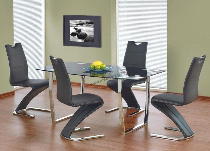 Nowoczesny stół Marcus będący połączeniem szkła oraz stali chromowanej.
