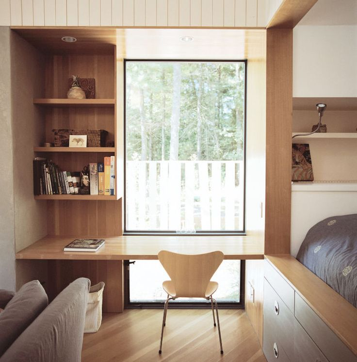 Modern small space Rhode Island cottage with Arne Jacobsen chair, Pella windows, and writing desk