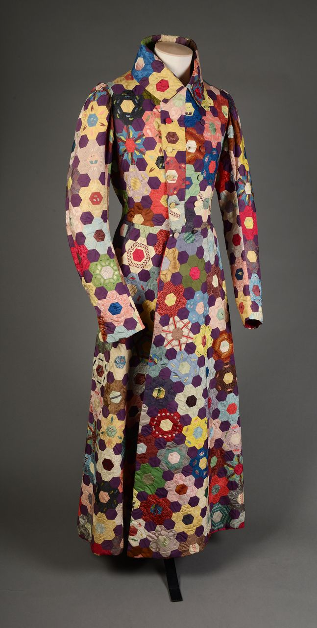 * Evening coat Made during World War One, this unique garment was made by a Mother for her son as he was convalescing from injuries sustained in the conflict. Made from silk hexagonal patchwork, the fabric dates from the 1890s. This dressing gown was worn as an evening coat by subsequent family members before it was donated to the museum in Norwich. The accession register notes that the donor was a lady of great wealth, great energy and noted eccentricity; she was also an artist in an…