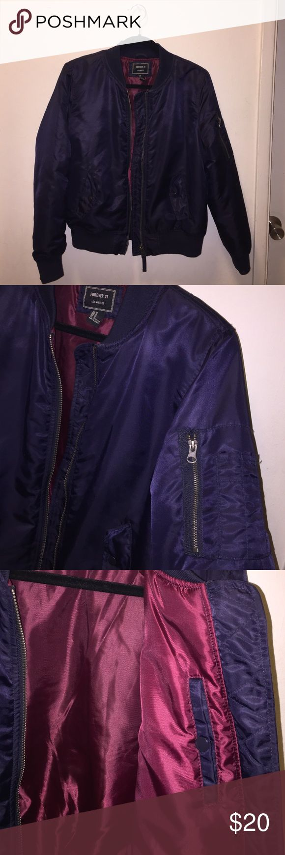 Navy Blue Bomber Jacket Padded bomber jacket. Worn a few times but in excellent condition. Deep burgundy interior with a pocket in the inside as well. Forever 21 Jackets & Coats Puffers