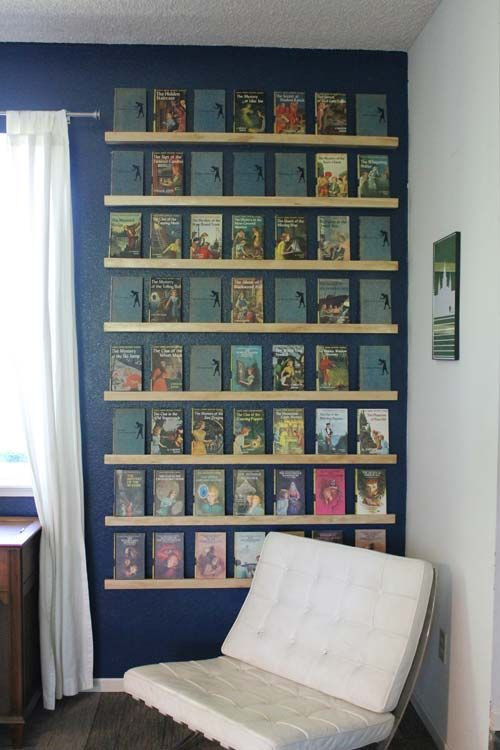 """""""Reader Amy F. displays the vintage Nancy Drew books that she inherited from her grandma on shelves lovingly made by her husband. """""""