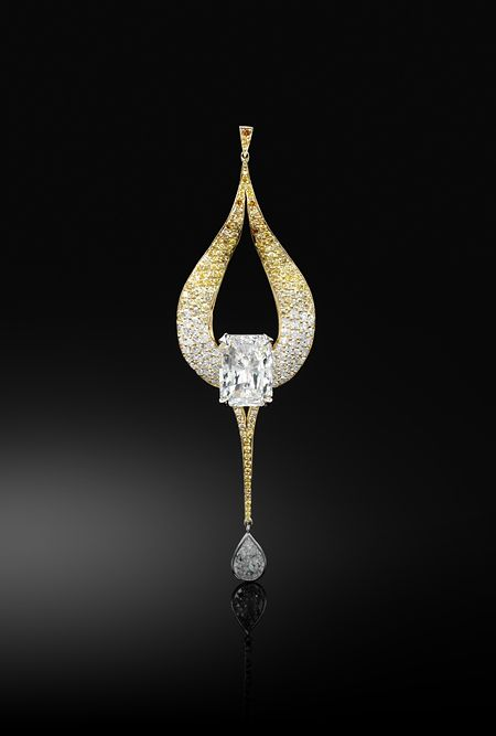 Flaming Ambition  Diamond pendant, centring on an impressive emerald-cut diamond weighing 8.20 carats within rolling and licking flames set with 185 brilliant-cut diamonds of orange through to yellow tints, suspending a pear-shaped diamond weighing 1.19 carats, mounted in 18k yellow and white gold.
