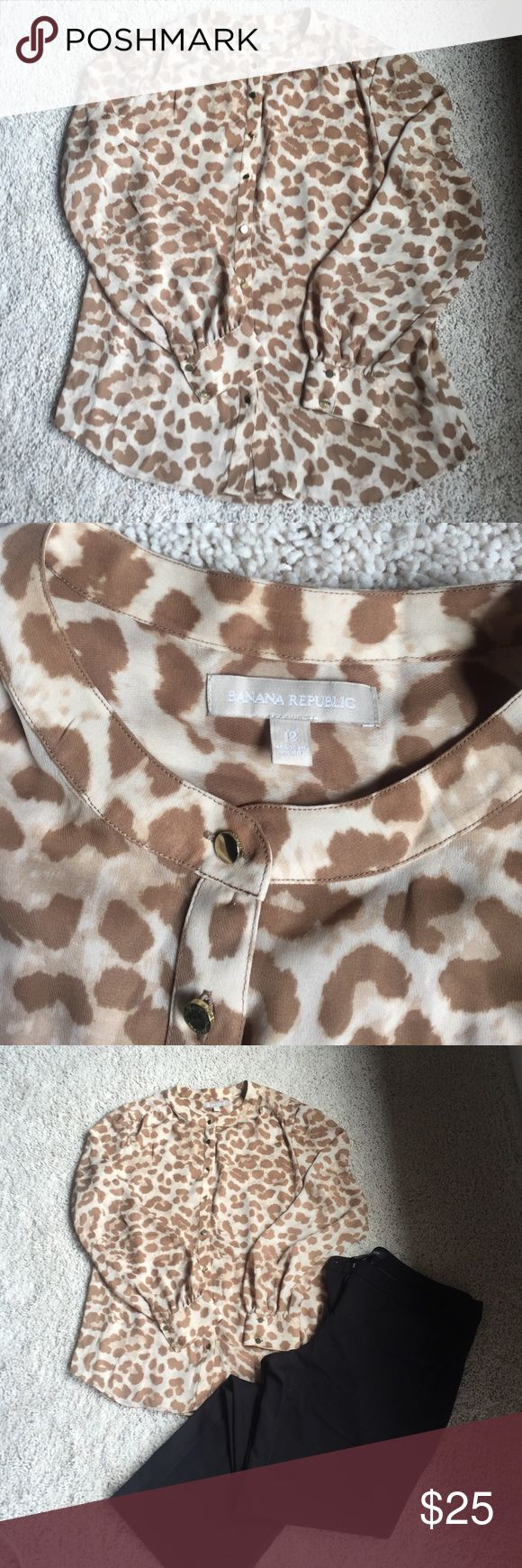 Banana Republic animal print top Such a cute animal print top.  So mad it's too big on me now!  100% polyester.  Excellent used condition. Banana Republic Tops Blouses