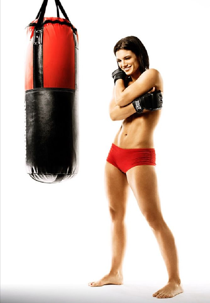 This is what a female boxer looks like...therefore, I am finding a personal boxing trainer ASAP! Great work out and releases tension. Btw this is Gina Carano a female thai boxer/ MMA fighter. I'd rather look like this than boney and skinny any day!