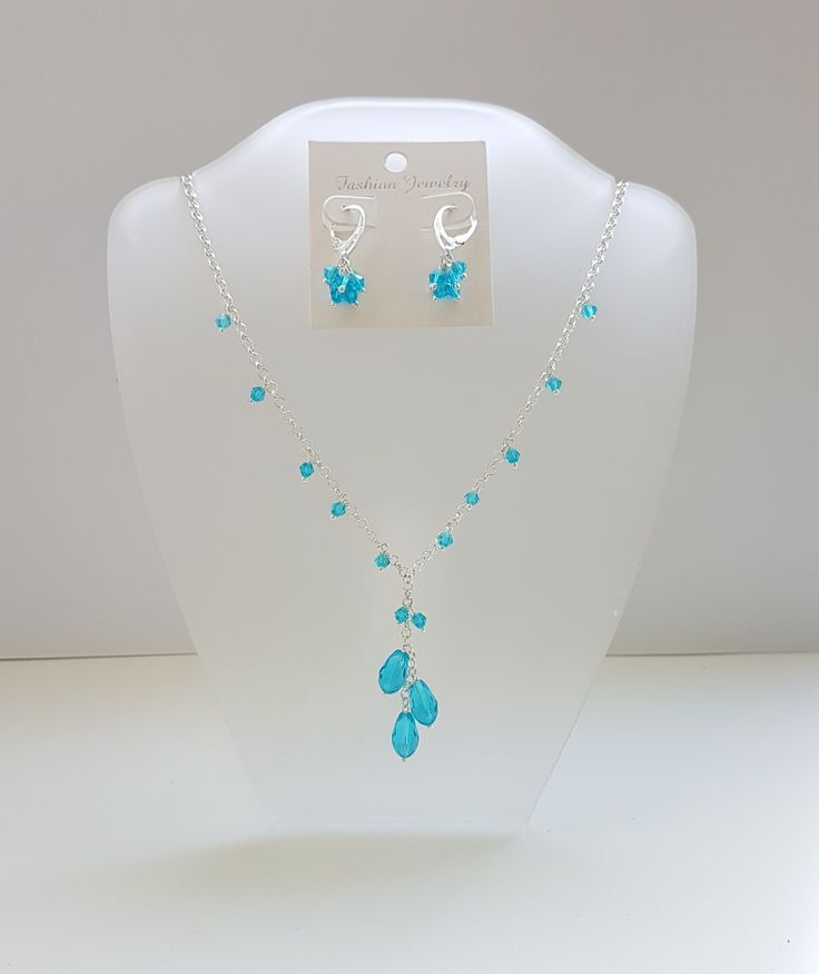 Easy to make. Glassbeads, necklace and earrings with 925 silver hoops.
