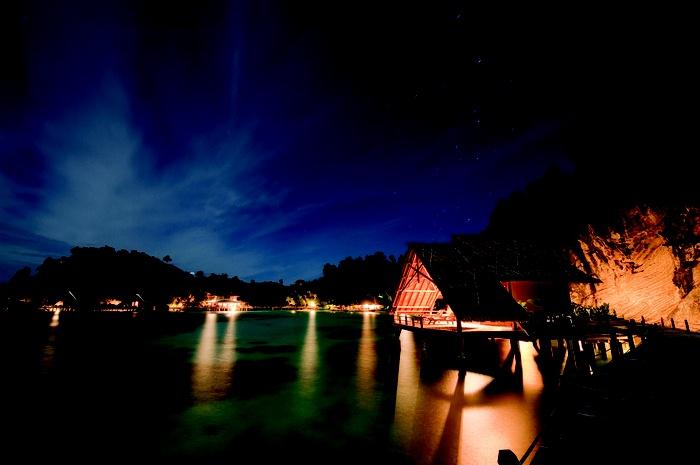 Misool Eco Resort at night. Photo by Juergen Freund courtesy of Misool Eco Resort via The Jakarta Post Travel.