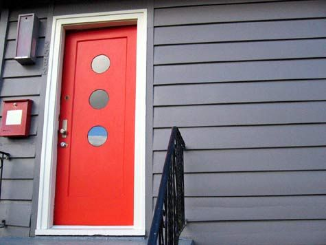 Sneak Peek: Best of Red! A bright red door in Vancouver heralds the circle motif inside. #sneakpeek #red