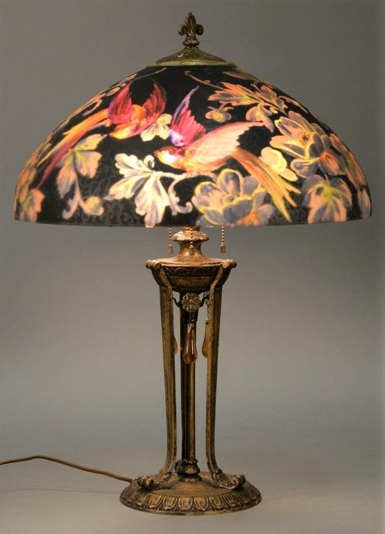 Handel Peter Broggi Birds of Paradise table lamp, reverse painted with brightly colored exotic birds among bright colored blossoming flowers and foliage against rich black background ~ Realized Price $9,900.00    #nadeausauction