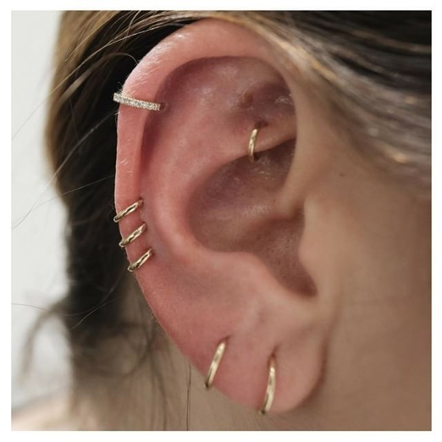 Seven different rings all over this ear, including a Diamond Eternity Ring, make for a beautifully Curated Ear || Shop this Instagram from @maria_tash