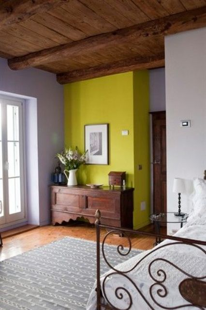 neon yellow accent wall looks fantastic in a vintage and rustic style bedroom