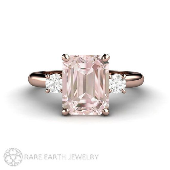 A stunning contemporary 3 stone engagement ring featuring a lovely 2ct emerald cut Pink Morganite and two sparkling conflict free diamonds, .20ct total