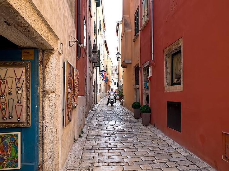 Grisia Street in Rovinj, Croatia, the main road leading to Saint Euphemia Church, which crowns the hill. Grisia Street is renowned for its art galleries and working artists.t