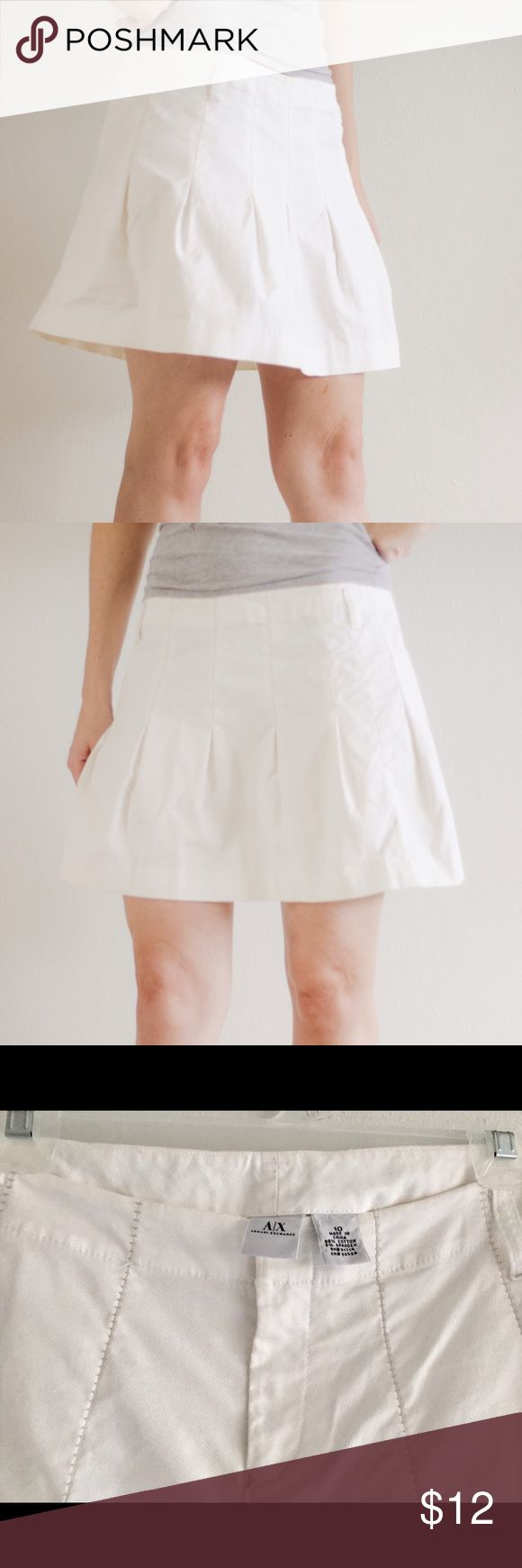 Armani Exchange White Skirt This classy skirt is in perfect condition. I love their wide and cozy style. I used it only twice. It has zipper in the front and handles for the belt. 98% cotton, 2% spandex. Size: 10  ~All offers welcome  ~Bundle + save ~Available for any questions Armani Exchange Skirts Mini