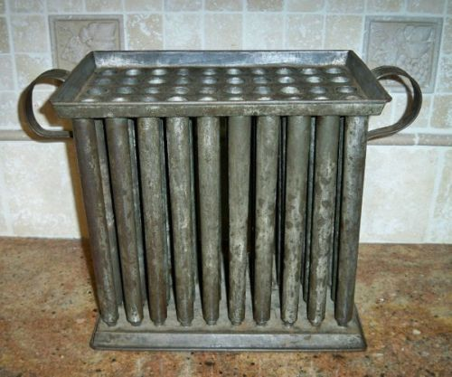 "RARE Antique Primitive 50 Tube Candle Mold 1800's~2 Handles~Tin Metal~11"" High.    Sold  Ebay   490.00"