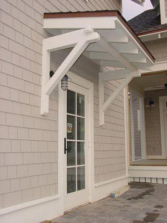 Overhang, light position and glass door for garage.