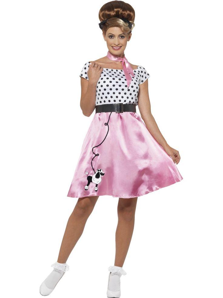 Fiftarimekko. Ihana fiftarityyliin sopiva pinkki-valkoinen mekko on viimeistelty pilkullisella yläosalla sekä hauskalla puudelinkuvalla, joka somistaa mekon helmaa. Mekko on tyttömäinen, kuten fiftarityyliin kuuluukin. Vuosikymmenen tyyliä mukaillen naamiaisasuun kuuluu myös kaulaan solmittava huivi sekä vyötäröä korostava vyö.