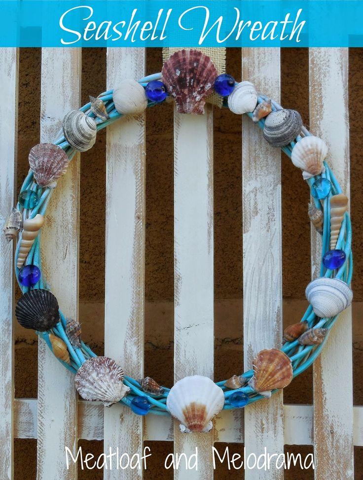 Diy seashell wreath on a white fence