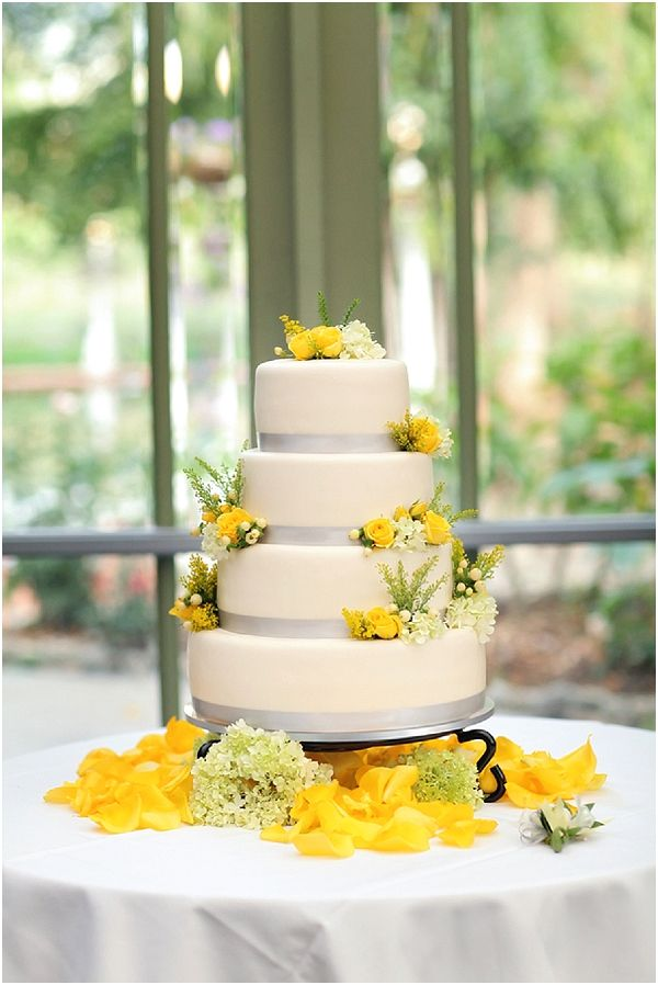 White, grey and yellow wedding cake