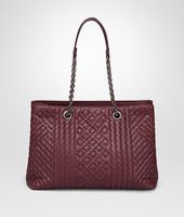 Shop Bottega Veneta® Women's MEDIUM TOTE BAG IN BAROLO INTRECCIATO CALF LEATHER, EMBROIDERED DETAILS. Discover more details about the item.