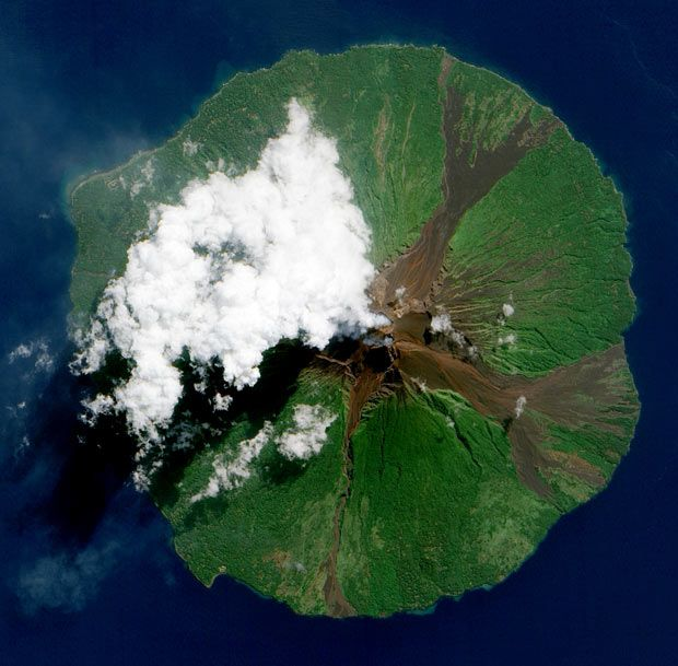 NASA image of Papua New Guinea's Manam Volcano releasing a thin, faint plume as clouds clustered at the volcano's summit, taken by The Advanced Land Imager (ALI) on NASA,s Earth Observing-1 (EO-1) satellite, over Manam island, 8 miles off the coast of mainland Papua New Guinea