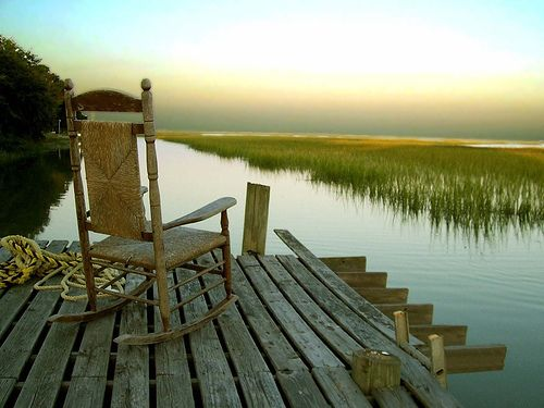 Sitting on the dock in a rocking chair. Each one on its own is relaxing, but put them together ...... bliss.