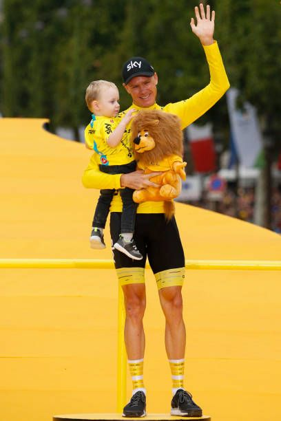 Tour de France 2017's winner Great Britain's Christopher Froome celebrates his overall leader yellow jersey with his baby Kellan on the podium at the...