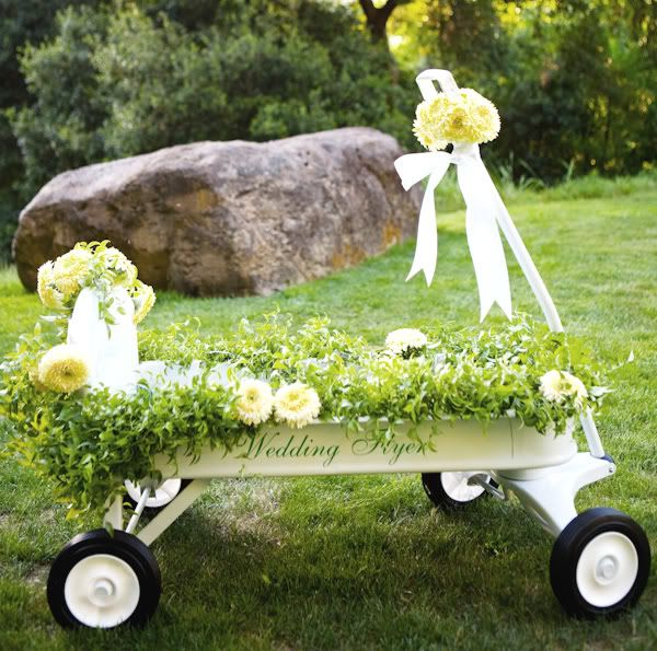 ice+drinks in a red flyer wagon, stick in stems of flowers and greens around the edges. Add on burlap/ribbon and voila!
