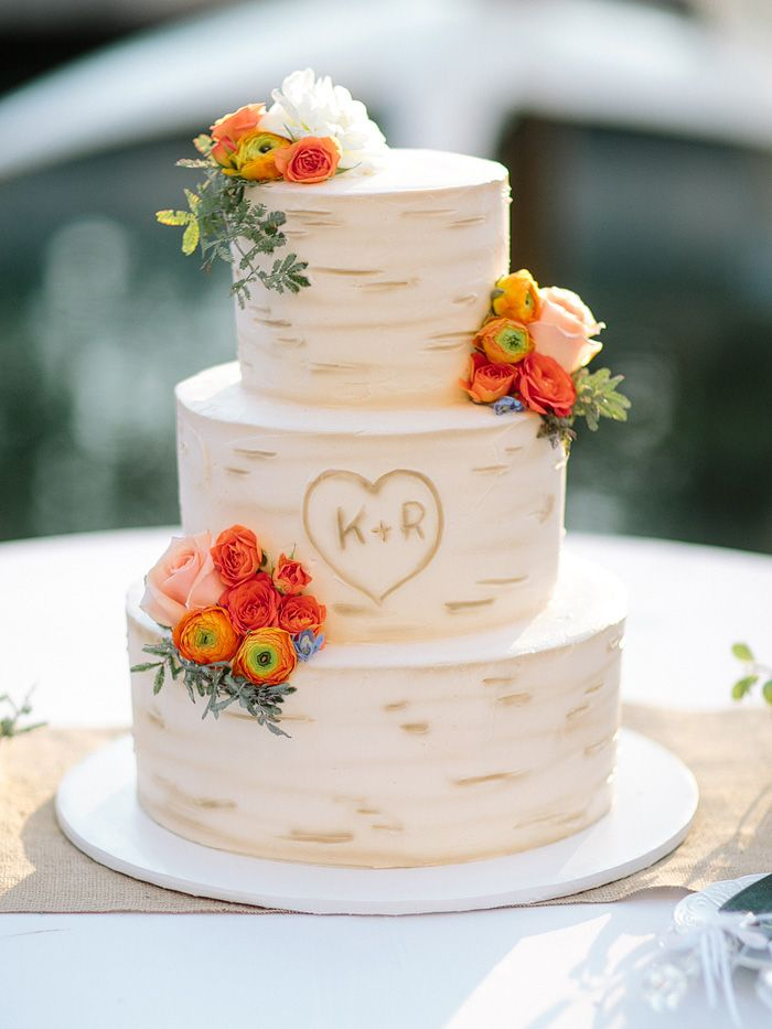 LOVE this birch bark patterned wedding cake with orange flowers