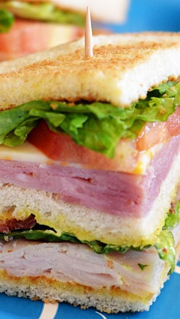 Delicious Club Sandwiches _ Ham, turkey, bacon and cheese? What's not to love!? They're also super easy and quick to make. Perfect for family night!