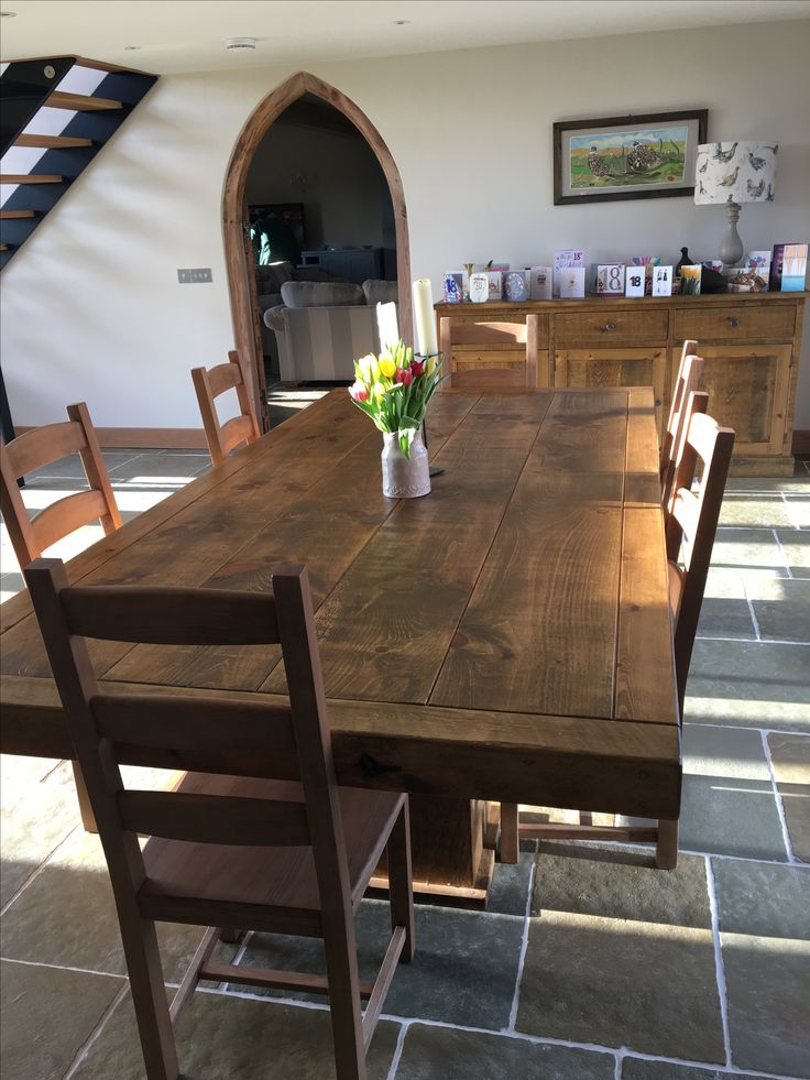 One of our Rustic plank Butchers tables with Ladderback chairs in a customers home. Cobwebs Furniture Company.