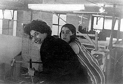 Heather Granger (L) and Joan Garrick working puppets from gantry.