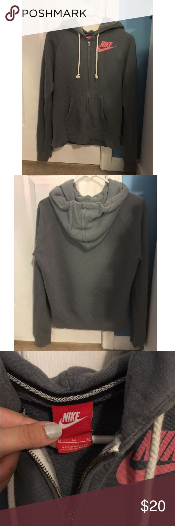 Nike grayish blue zip up hoodie Nike Factory Outlet zip up hoodie  Grayish blue Only worn a few times, the perfect lounge sweater. Women's size medium In very good condition Nike Sweaters