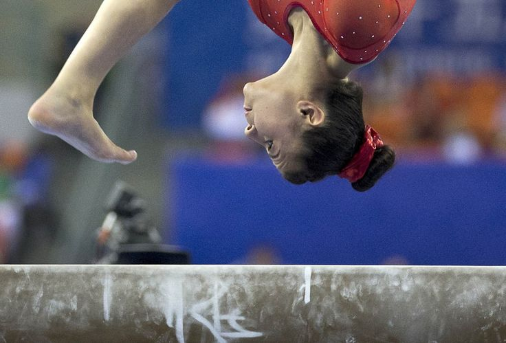 Claudia Fragapane of Britain keeps her eyes on the balance beam as she competes in the women's qualifying round of the Artistic Gymnastics World Championships at the Guangxi Gymnasium in Nanning, capital of southwest China's Guangxi Zhuang Autonomous Region Monday, Oct. 6, 2014. (AP Photo/Andy Wong)