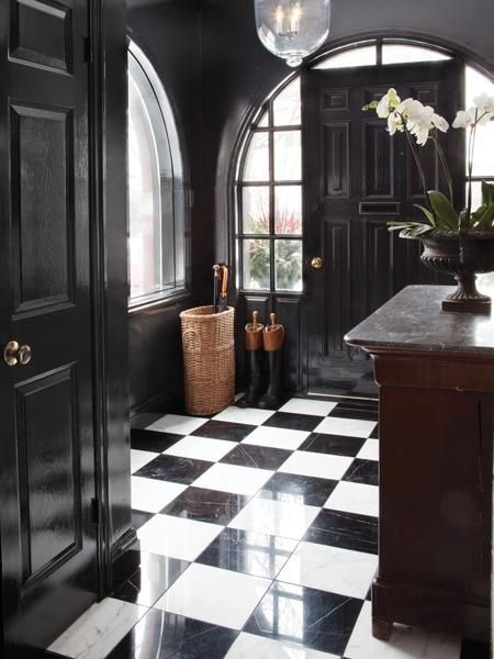 The power of black in an interior ..  Strong statement for a strong house with great bones.  Not for the faint at heart.