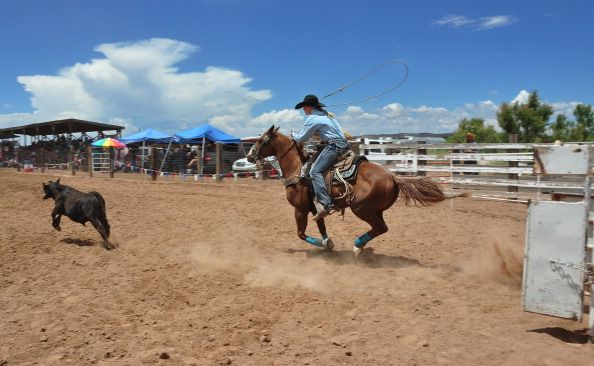 A rodeo cowgirl competes in the breakaway roping contest at the Rodeo de Galisteo an amateur rodeo in the small village of Galisteo in northern New...