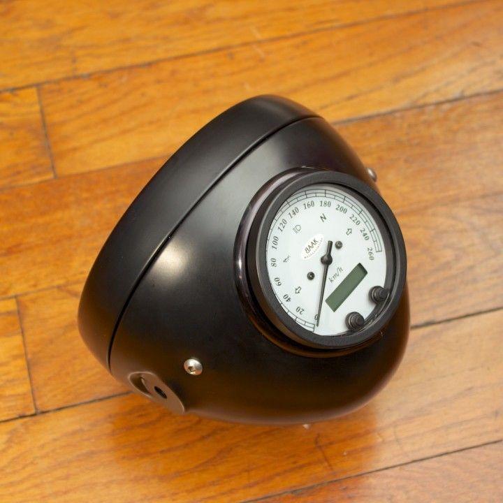 Integrated Speedometer/Headlight Bucket.