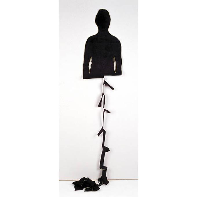 Oplossing 2. Wandobject van een levensgrote, menselijke figuur in zwart katoen.