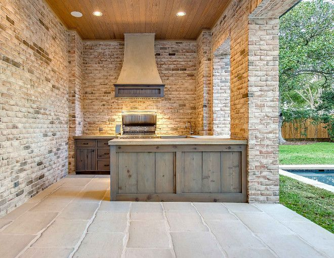 Outdoor kitchen cabinet. Outdoor kitchen with reclaimed wood cabinet. Reclaimed wood cabinets for outdoor kitchens. #reclaimedwoodcabinet #outdoorkitchencabinet #outdoorkitchen Elizabeth Garrett Interiors.