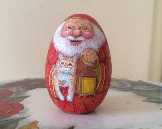 Santa Claus holding a kitty by WoodenEggArt on Etsy, $55.00
